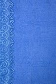 Blue terry towel as textured background with lace frame