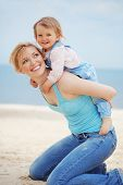 foto of mother daughter  - Happy family resting at beach in summer - JPG