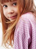 Close-up portrait of cute child girl looking at camera