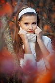 Portrait of beautiful girl in autumn park