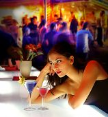 picture of night-club  - woman drinking cocktail during a party - JPG