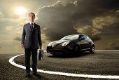 asian business man standing near to sport car