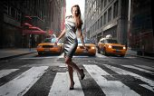 elegant model crossing a NY city street