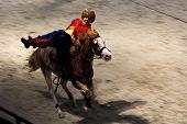Cossack horseman performing stunts on horseback