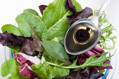 Organic Salad And Spoon Of Olive Oil