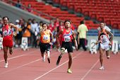 KUALA LUMPUR - AUGUST 15: Amputees run the 100m race at the track and field event of the fifth ASEAN