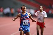 KUALA LUMPUR - AUGUST 15: Thailand's amputee athlete Sangat Chaikhini wins the 800m race at the track and field event of the fifth ASEAN Para Games on August 15, 2009 in Kuala Lumpur.