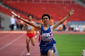 KUALA LUMPUR - AUGUST 18: Thailand's visually impaired relay team wins the 4x400m race at the track