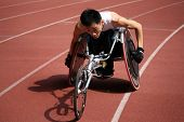 KUALA LUMPUR - AUGUST 16: Singapore's wheel-chair athlete competes at the track and field event of the fifth ASEAN Para Games on August 16, 2009 in Kuala Lumpur, Malaysia.