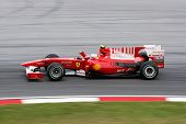 KUALA LUMPUR - APRIL 2: Ferrari's driver Fernando Alonso takes to the tracks on practice day at the