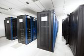 stock photo of byte  - A server room with black servers - JPG