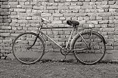 old retro bicycle leaning against a wall