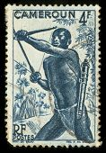 Vintage stamp from Cameroon depicting a tribal hunter with bow and arrow
