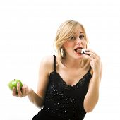 Woman eating candy instead of apple