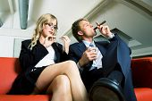 Boss smokes and drinks, secretary files her nails