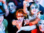 Crowd cheering - their rock idol or simply having fun in a club (Focus on hands!)