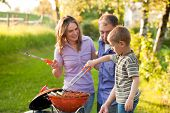 picture of bbq party  - Family having a barbecue party - JPG
