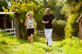 stock photo of summer fun  - Mature or senior couple doing sport outdoors - JPG