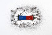 Red And Blue Bar Magnet Or Physics Magnetic With Iron Powder Magnetic Field On White Background. Sci poster