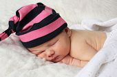Newborn Baby With Stripey Hat