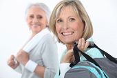 stock photo of broad-bodied  - mature women at fitness center - JPG