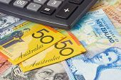 foto of nzd  - Australia and New Zealand currency pair commonly used in forex trading with calculator - JPG