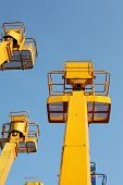 pic of cherry-picker  - Cherry picker platform from below and blue sky - JPG
