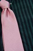 Pink Necktie Tied On Black Pinstriped Shirt