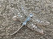 stock photo of dowry  - jewelry box with a dragonfly on top of it - JPG