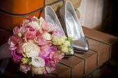 Women's Shoes And Flower Bouquet