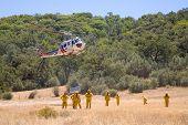 Brand bemanning met helikopter