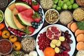 Health food concept with fresh fruit, vegetables, seeds, pulses, grains and cereals with foods high  poster