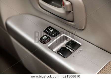 poster of Close Up Of A Door Control Panel In A New Modern Car. Arm Rest With Window Control Panel, Door Lock