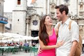 Tourists - happy couple in Cuba. Havana having fun during travel. Young interracial couple, Asian wo