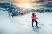 Cheerful Backpacker Woman On Fresh Powder Snow, Ski Touring On The Snowy Slopes. Backcountry Skier W poster