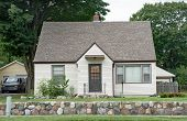 Low Income Urban House with Stone Wall  poster