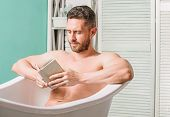 Nervous System Benefit Bathing. Relax Concept. Man Muscular Torso Relax Bathtub And Read Book. Relax poster