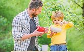 Little Boy And Dad Eat. Nutrition Kids And Adults. Organic Nutrition. Healthy Nutrition Concept. Nut poster