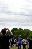 People Watching The Space Shuttle Discovery Flying Over The Washington, D.c. Area