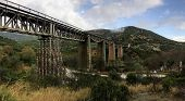Famous Old Gorgopotamos Bridge In Greece Near Lamia Which Was Blown Up In World War Ii. poster