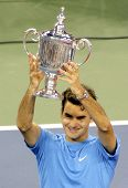 FLUSHING, NY - SEPTEMBER 10: Roger Federer holds his trophy after winning against Andy Roddick durin