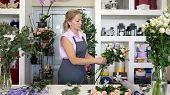 Professional Florist Woman Creates Lovely Flower Bouquet With Roses, Leaves And Gypsophila. Blonde M poster