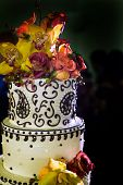 Uplose View Of Wedding Cake Topped With Flowers