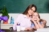 Teacher Kind Lady With Pupil. Doing Homework With Mom. Little Girl And Woman Sit At Desk. School Edu poster