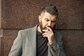 Smoking And Habits Concept. Hipster With Stylish Hair Thoughtful Concentrated Face With White Smoke  poster