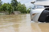 Cars Driving On A Flooded Road, The Broken Car Is Parked In A Flooded Road. poster