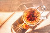 Morning Brewed In A Cup Of Black Tea And The Morning Sun. Shadow Falling From A Cup Of. Good Morning poster