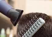 Making Modern Hairdress With Dryer And Round Comb, Close Up View. Hairstylist At Work, Photographed  poster
