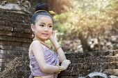 Closeup Shot Of Cute Thai Girl Wearing Thai Traditional Clothing. She Turned To Look At Camera And S poster
