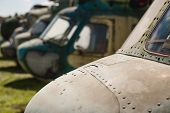 Old Military Helicopter. History Concept. Group Of Helicopters Outdoors poster